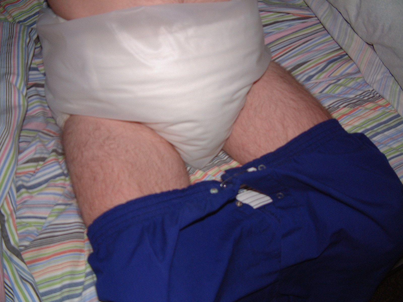getting ready for bed with a thick cloth diaper on