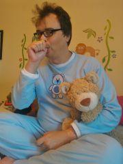 Me in my teddy bear pyjamas with Toast the teddy bear